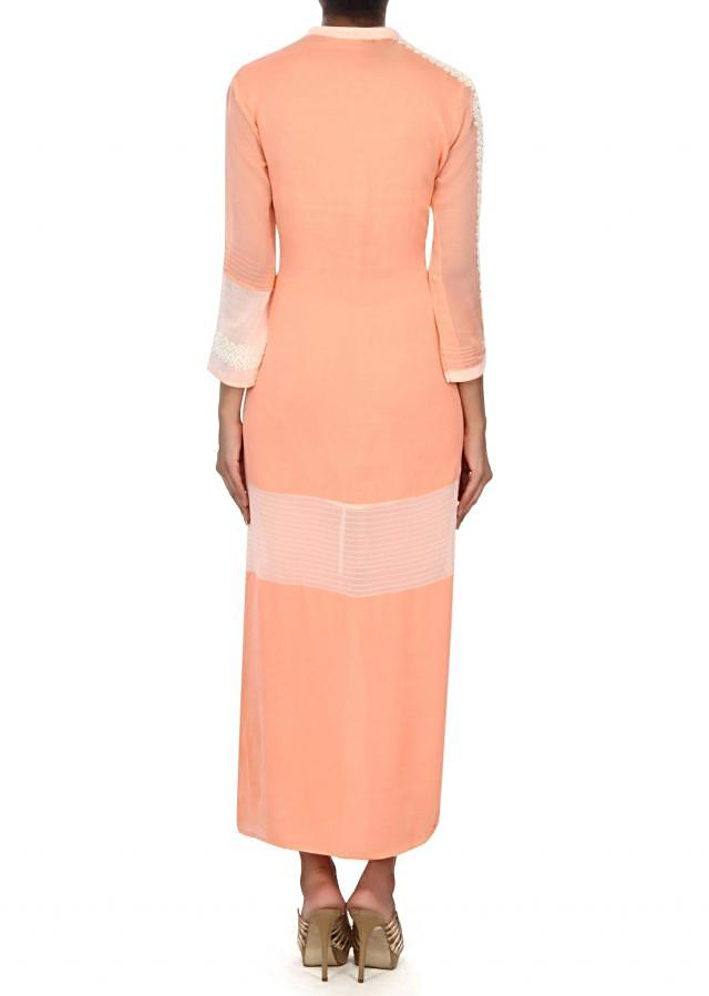 Peach kurti adorn in resham and pin tucks embroidery only on Kalki