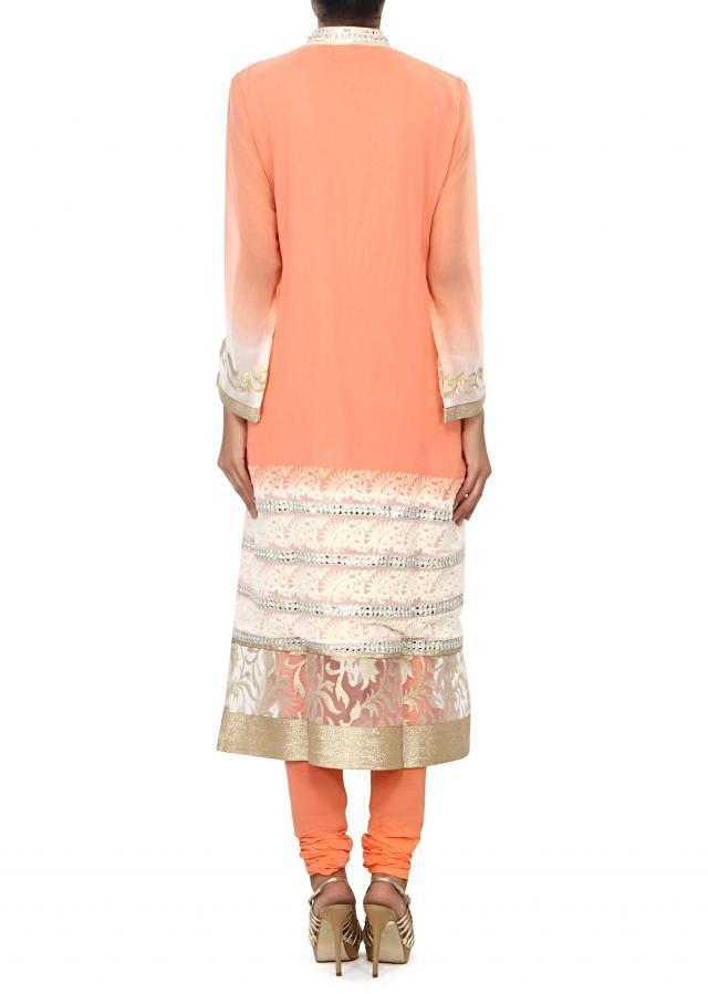 Peach kurti enhanced in embroidered hem line only on Kalki