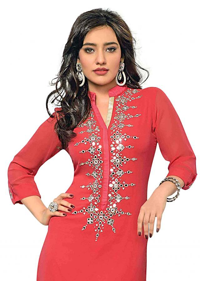 Peach kurti features with mirror embroidered palcket only on Kalki