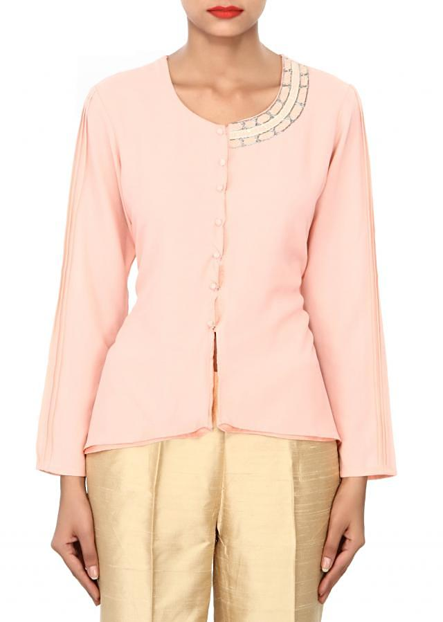 Peach kurti featuring in embellished neckline only on Kalki