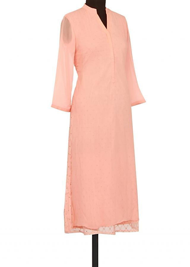 Peach kurti in fancy net only on Kalki