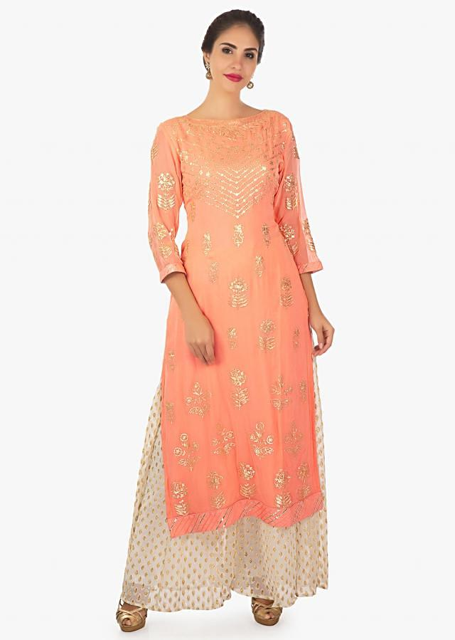 Peach kurti with paired with off white palazzo and a chiffon dupatta only on Kalki