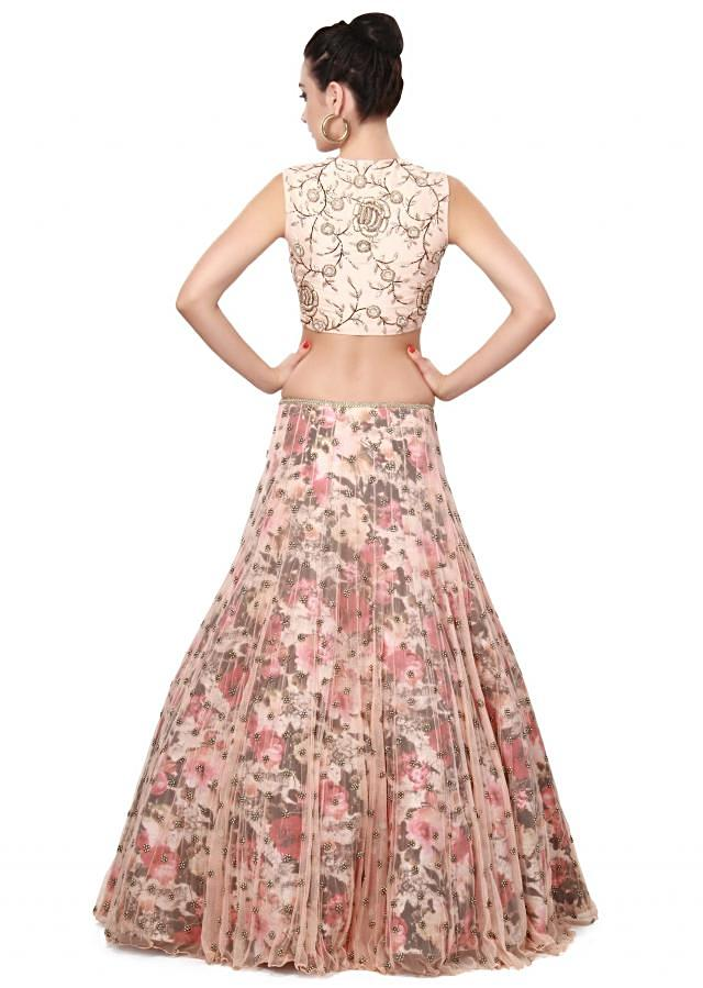 Peach lehenga matched with embroidered blouse only on Kalki