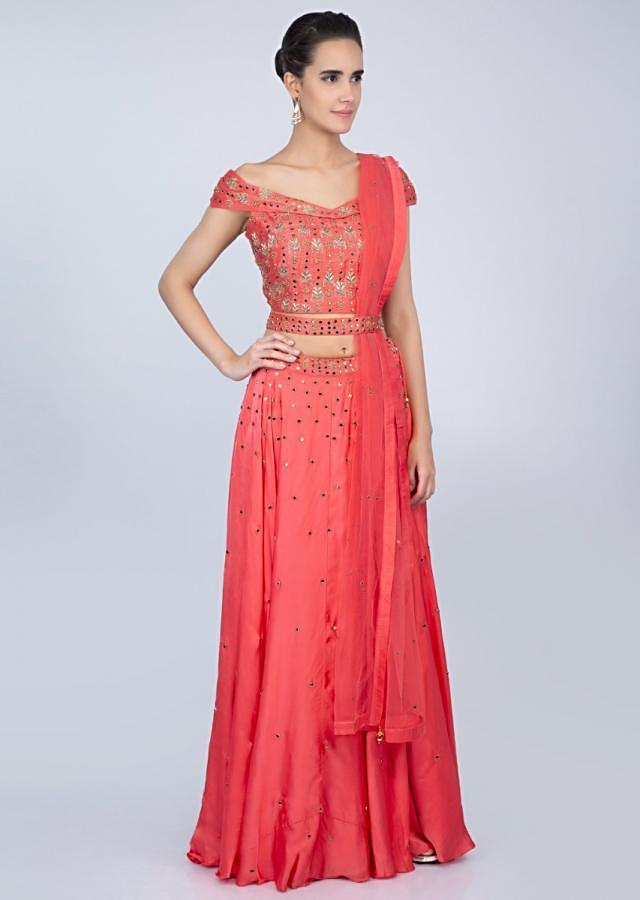 Peach lehenga with embroidered off shoulder blouse and net dupatta  only on kalki