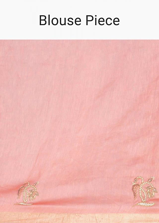 Peach linen saree adorn with floral embroidered butti only on Kalki