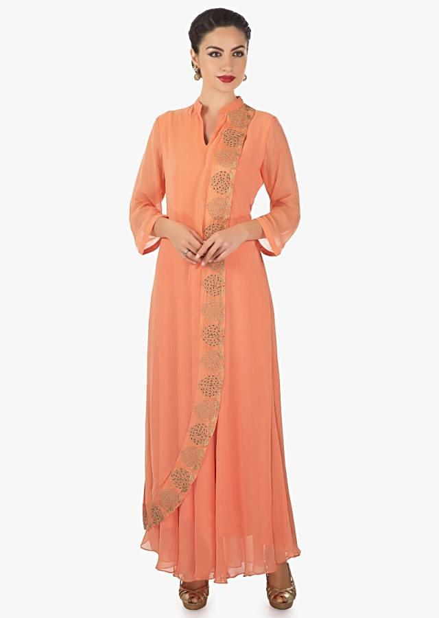 Peach ling dress with top layer highlighted in moti and zari work only on Kalki