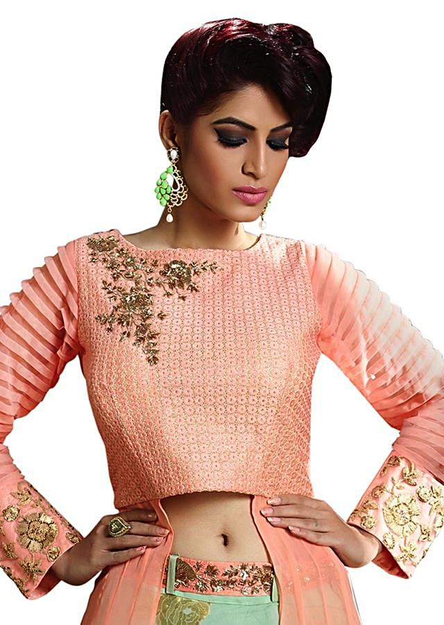 Peach long blouse with sea green lehenga