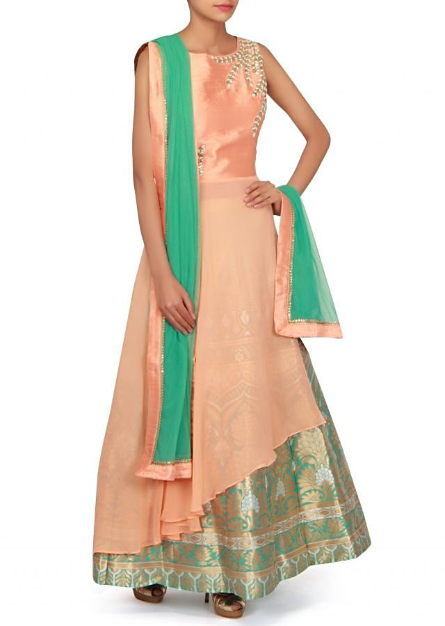 Peach long top matched with brocade skirt only on Kalki