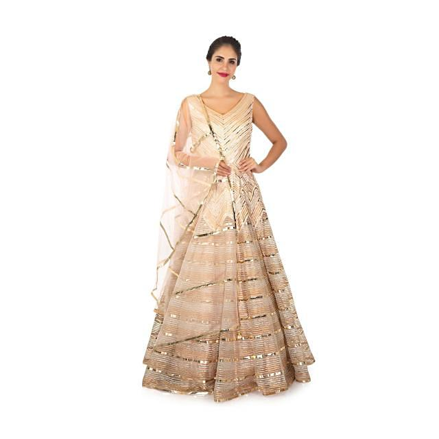 Peach net dress with gotta lace and applique work only on Kalki