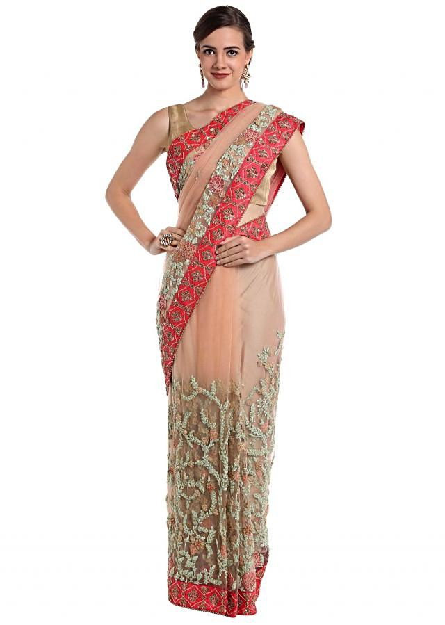 Peach net saree featuring thread work and sequins  only on Kalki