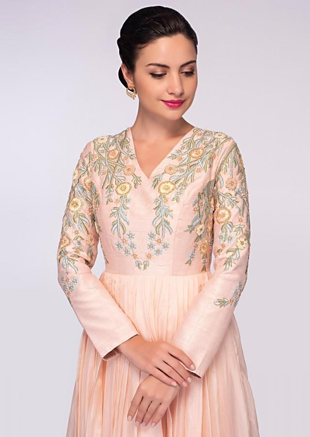 Peach organza gown with raw silk bodice intricated in floral resham embroidery only on Kalki