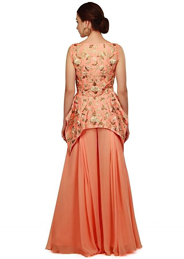 Peach peplum top with pleated palazzo pant only on Kalki