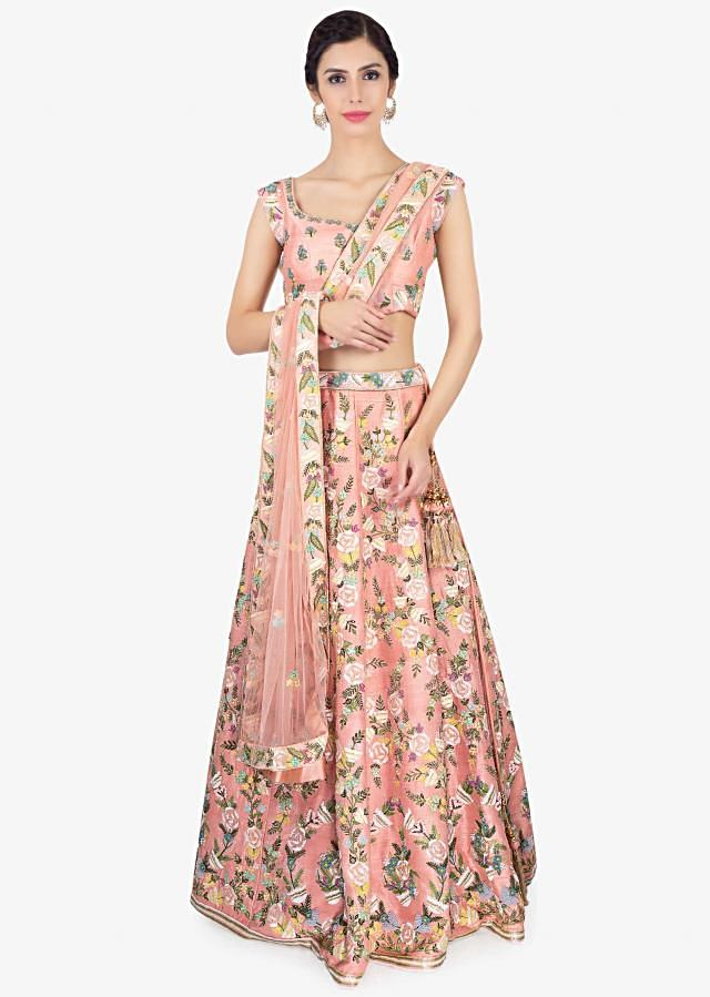 Peach raw silk embroidered lehenga and blouse paired with net dupatta only on Kalki