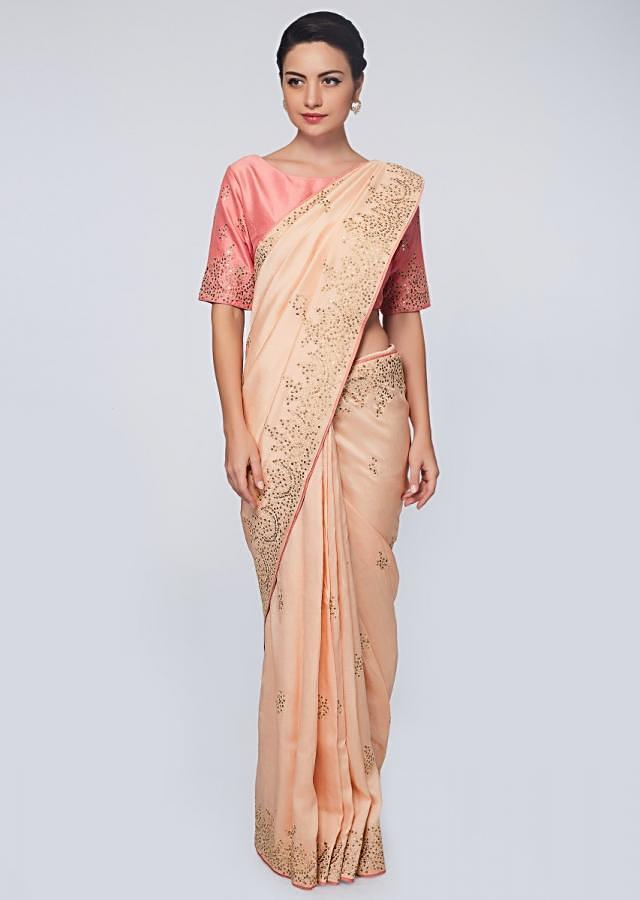 Peach raw silk saree in zari and sequins embroidered butti and border only on Kalki