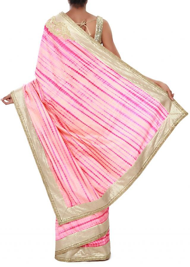 Peach saree adorn in batik and sequin embroidery only on Kalki