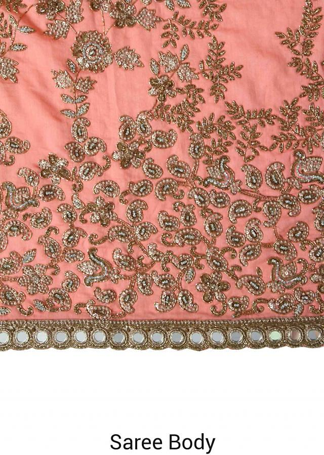 Peach saree adorn in floral and paisley motif embroidery only on Kalki