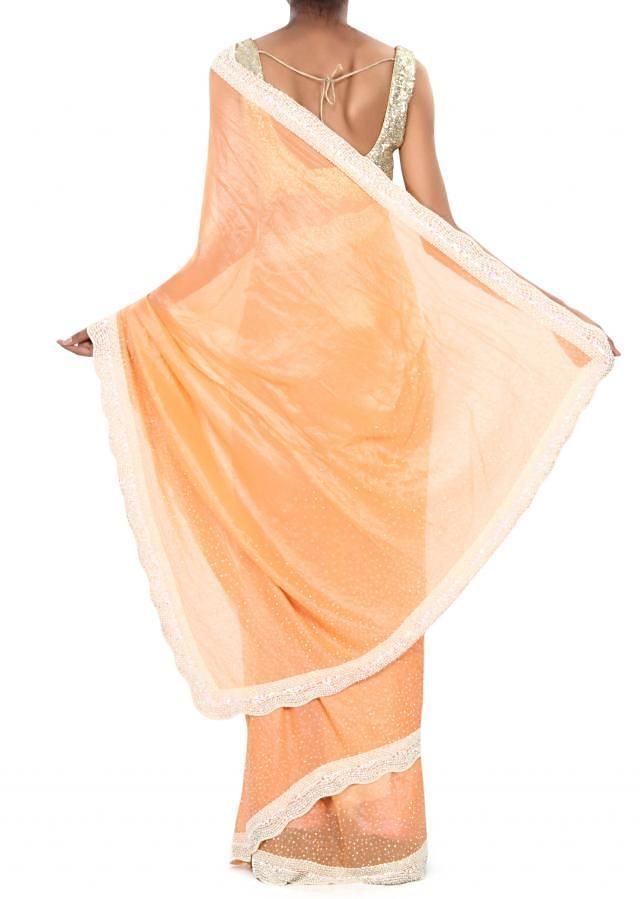 Peach saree adorn in pearl and kundan border only on Kalki