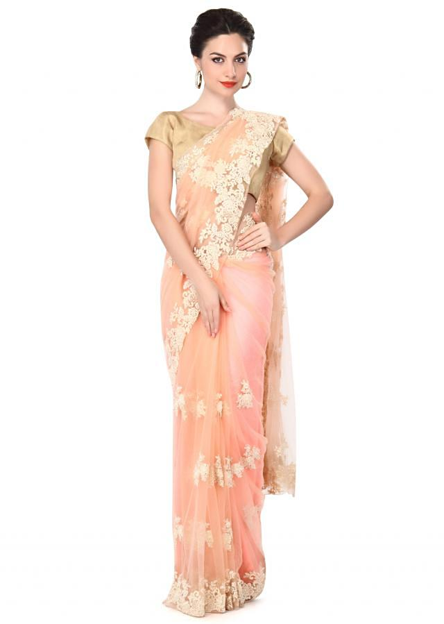 Peach saree adorn in thread and sequin embroidery only on Kalki