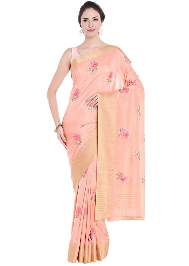 Peach saree embellished in rose motif print with weaved border only on Kalki