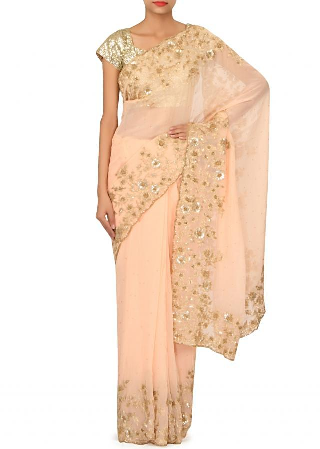 Peach saree embellished in zari and moti embroidery only on Kalki