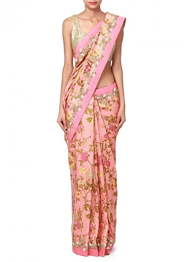 Peach saree enhanced in floral print and embroidered butti only on Kalki