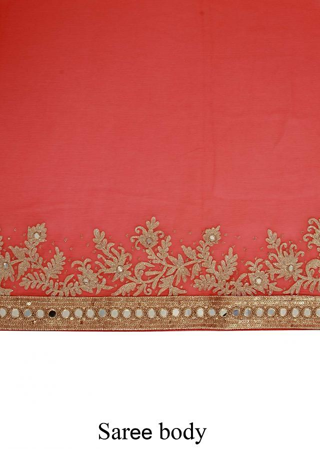 Peach saree enhanced in thread and mirror embroidery only on Kalki