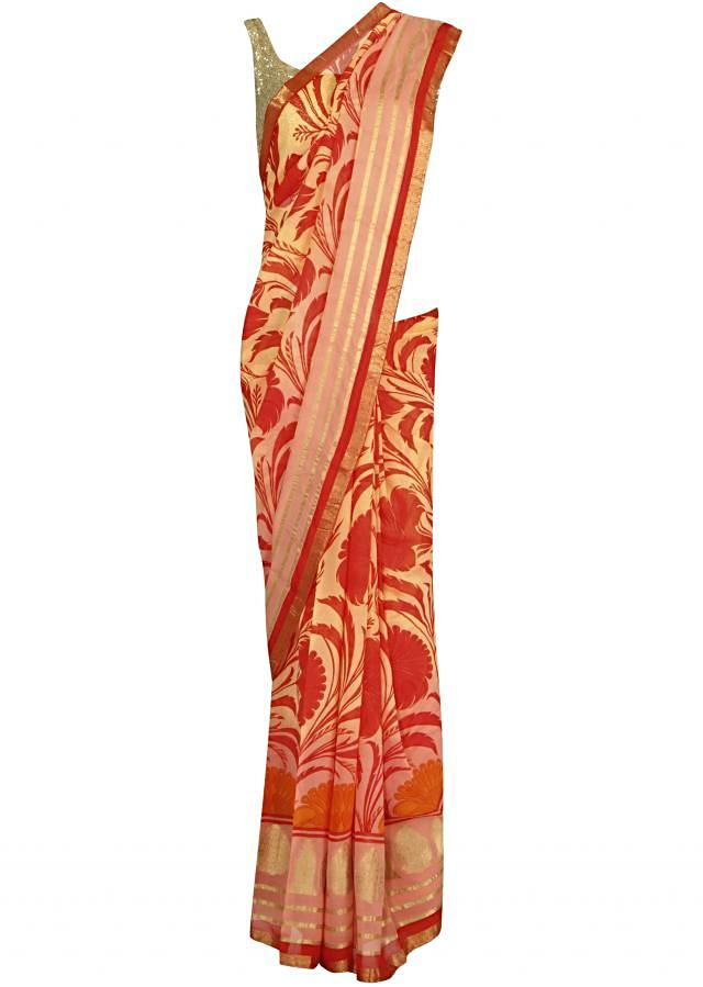 Peach saree features in coral print all over only on Kalki