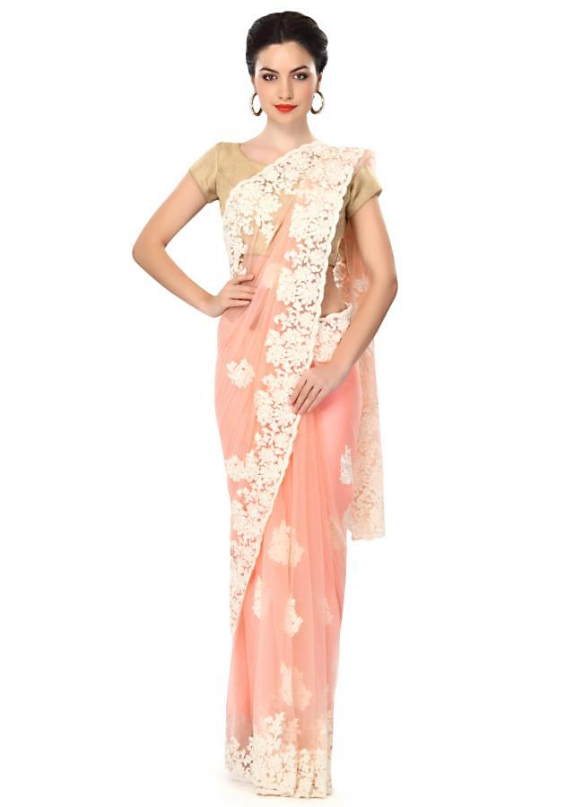 Peach saree featuring in resham embroidery only on Kalki
