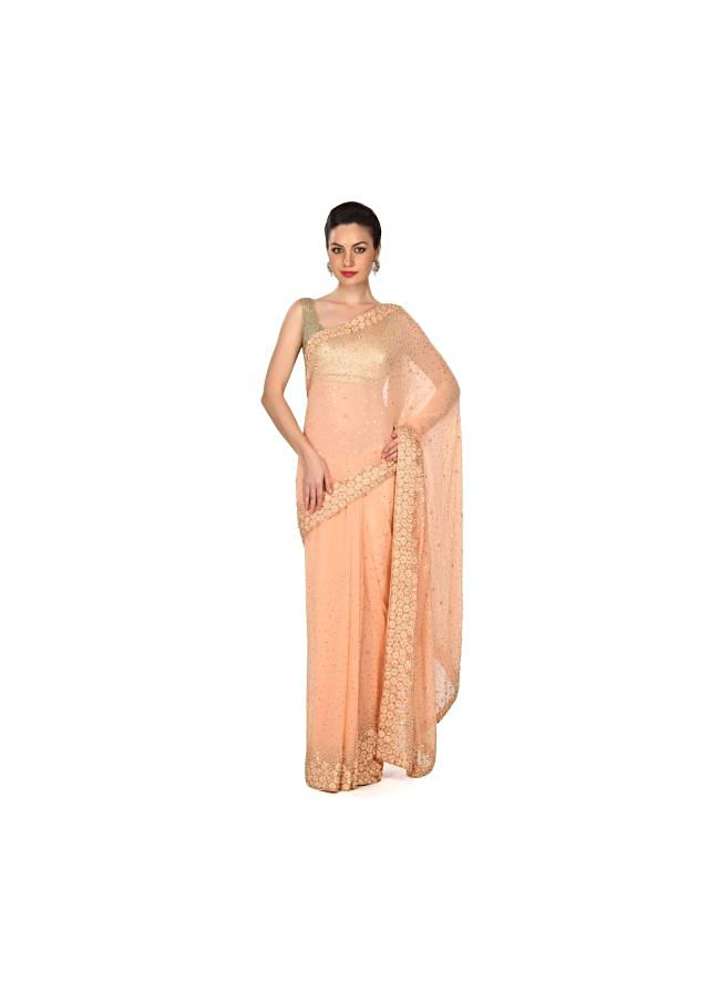 Peach saree with resham and pearl border only on Kalki