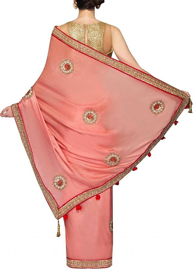 Peach satin georgette saree with cut dana and kundan only on Kalki