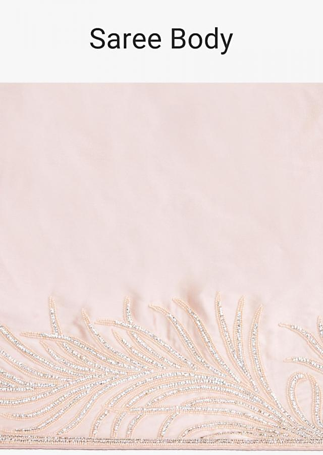 Peach satin saree with moti and stone embroidered border only on kalki