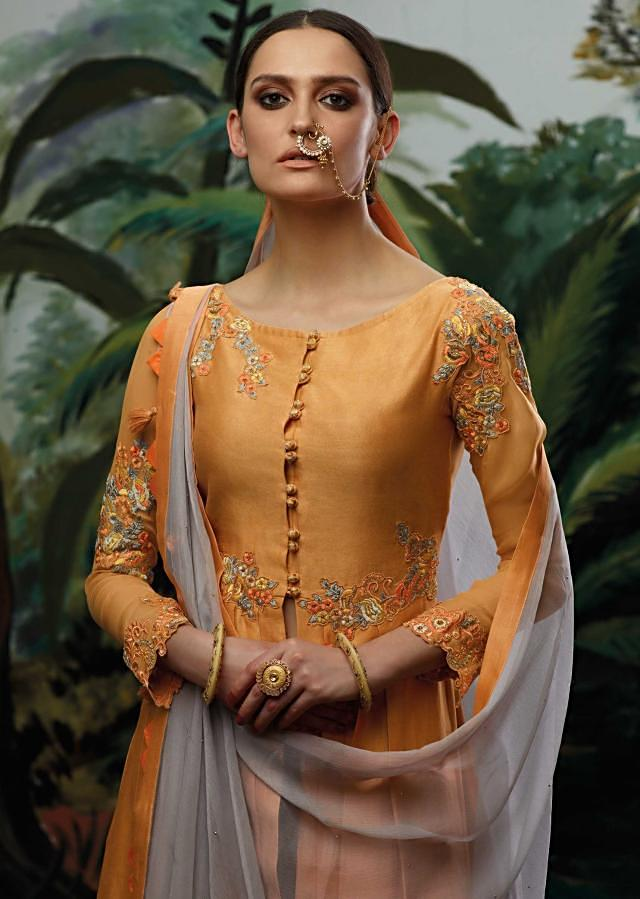 Peach semi stitched embroidery suit with center slit