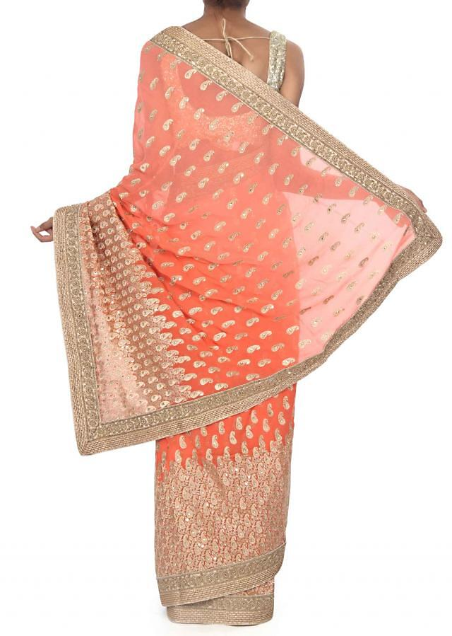 Peach shaded saree adorn in paisley motif embroidery only on Kalki
