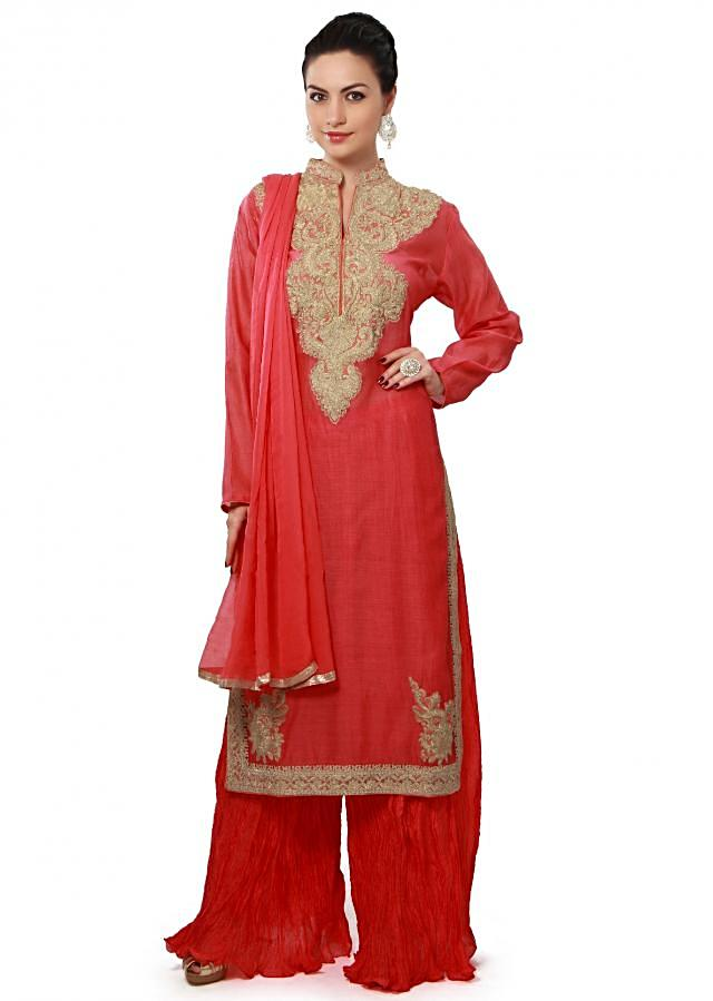 Peach straight fit suit enhanced in zari embroidered neckline only on Kalki