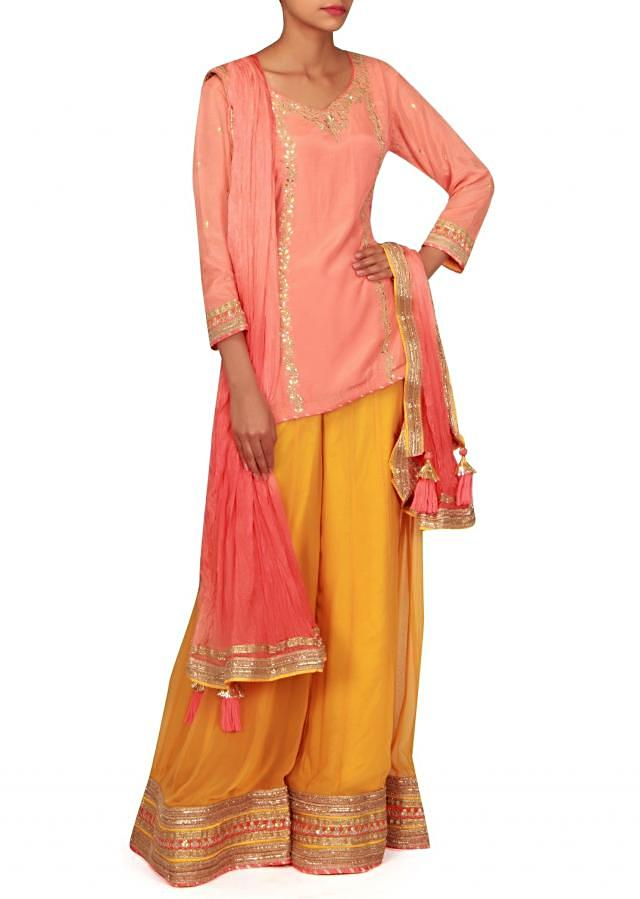 Peach straight suit matched with palazzo pant only on Kalki