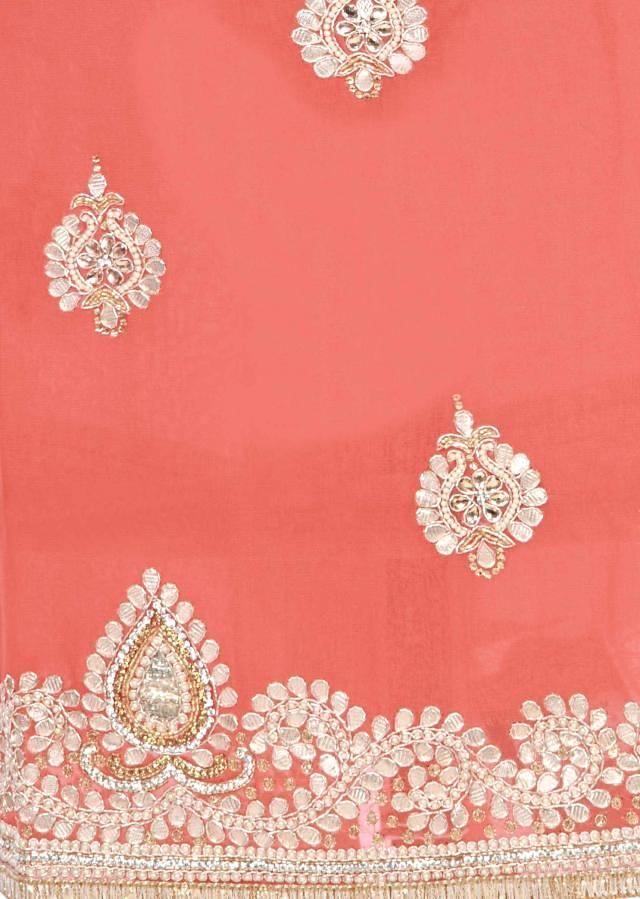Peach unstitched suit embellished in gotta patch work butti only on Kalki