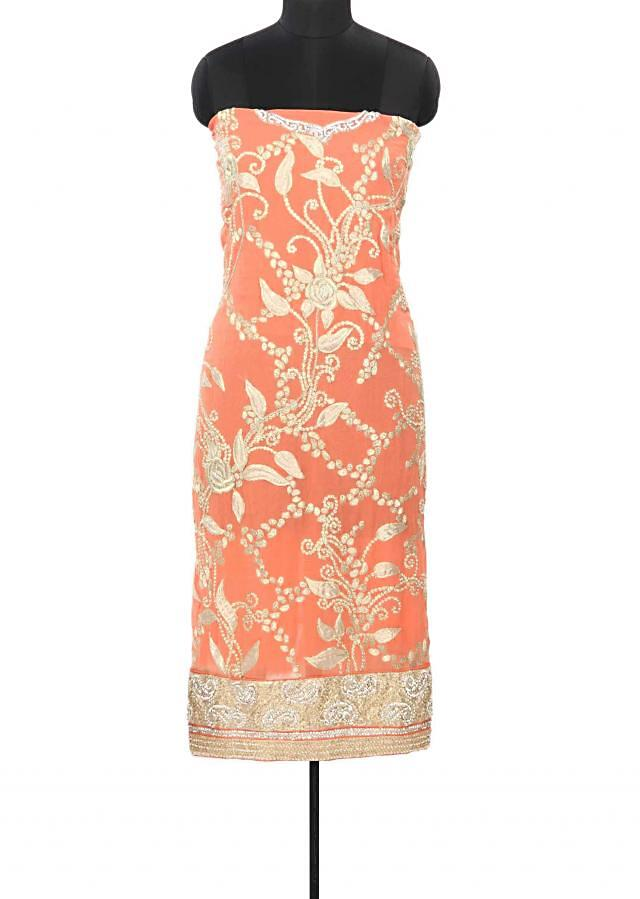 Peach unstitched suit enhanced in pearl and kundan embroidery only on Kalki