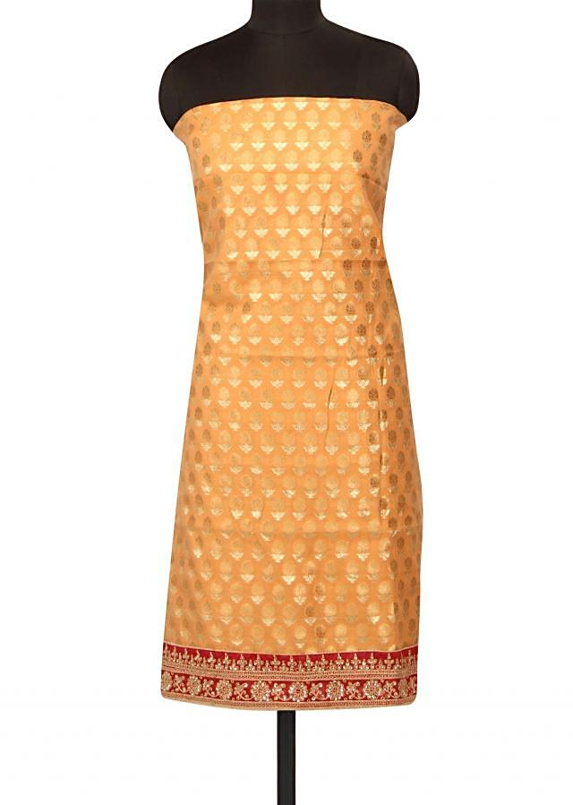 Peach unstitched suit with kundan and zari hem line only on Kalki