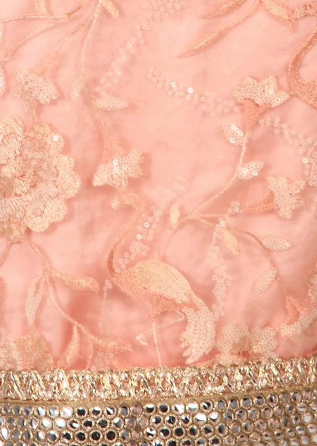 Peach unstitched suit adorn in resham and sequin only on Kalki