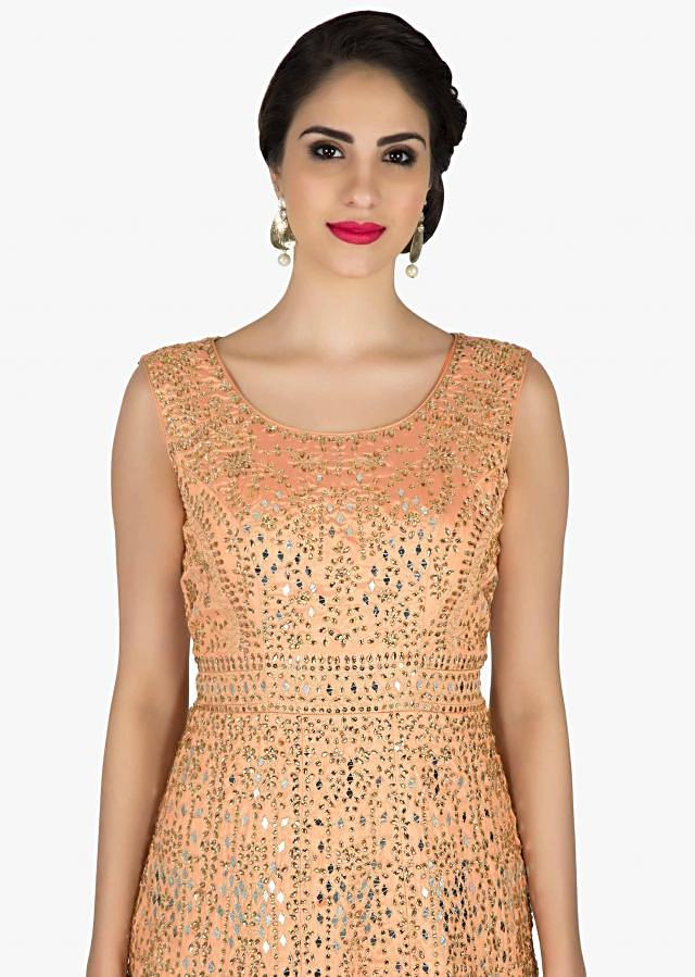 Peach anarkali suit embellished in kundan and zari embroidery all over only on Kalki