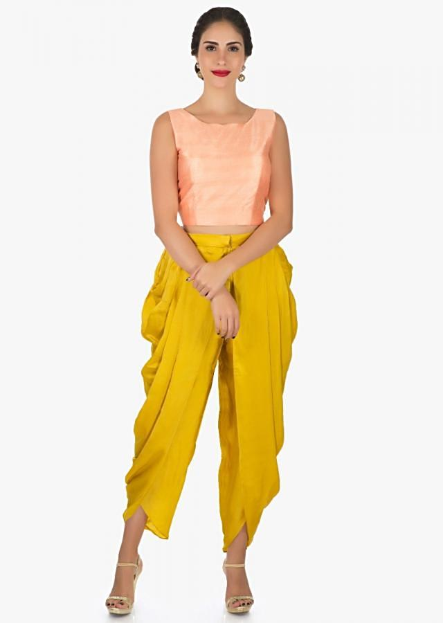 Peach and mustard dhoti suit with a over layer embellished in resham and sequin butti work only on Kalki