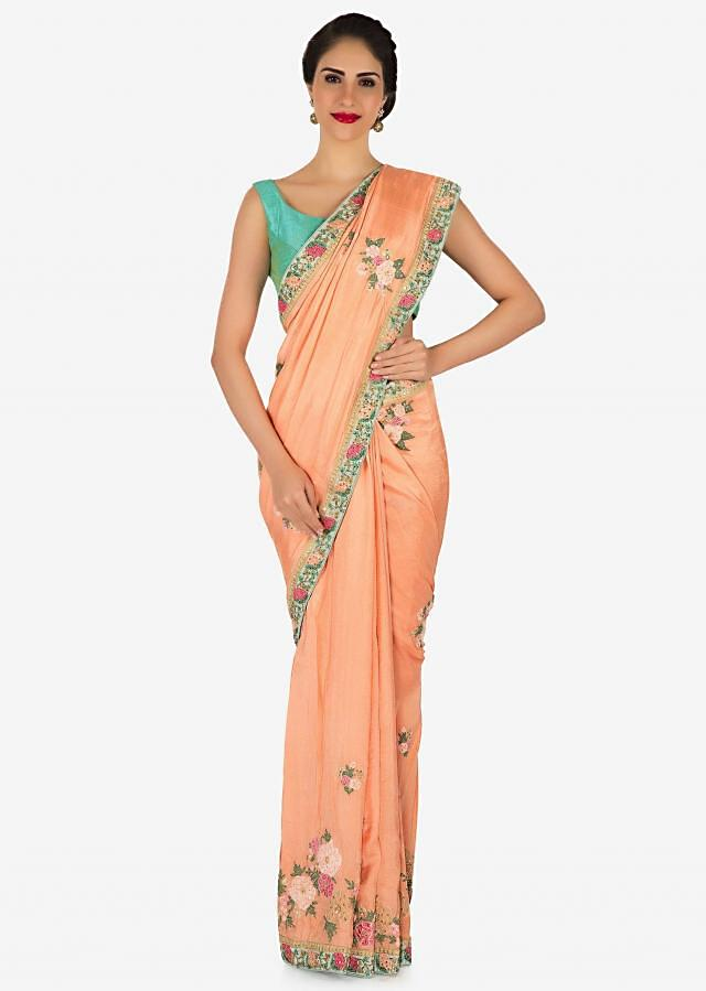 Peach cotton silk saree adorn in applique work in floral motif only on Kalki