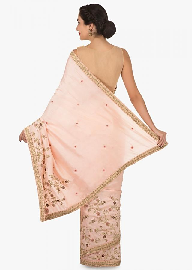 Peach cotton silk saree beautified in resham and sequin embroidery work only on Kalki