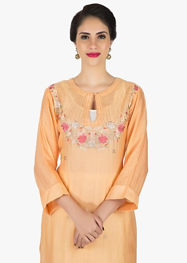 Peach dress in crush cotton enhanced in resham embroidery only on Kalki