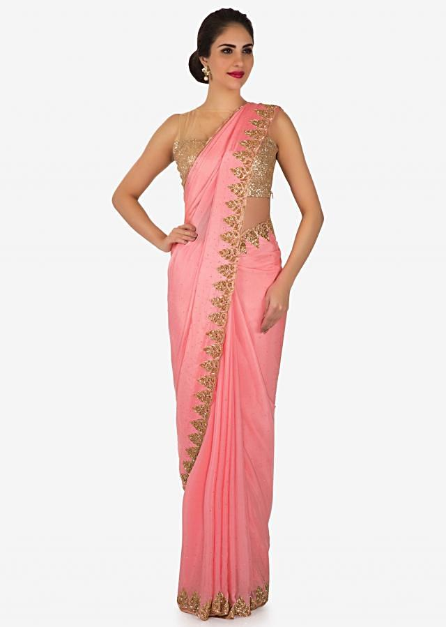 Peach georgette saree with unstitched blouse adorn in heavy cut dana work only on Kalki