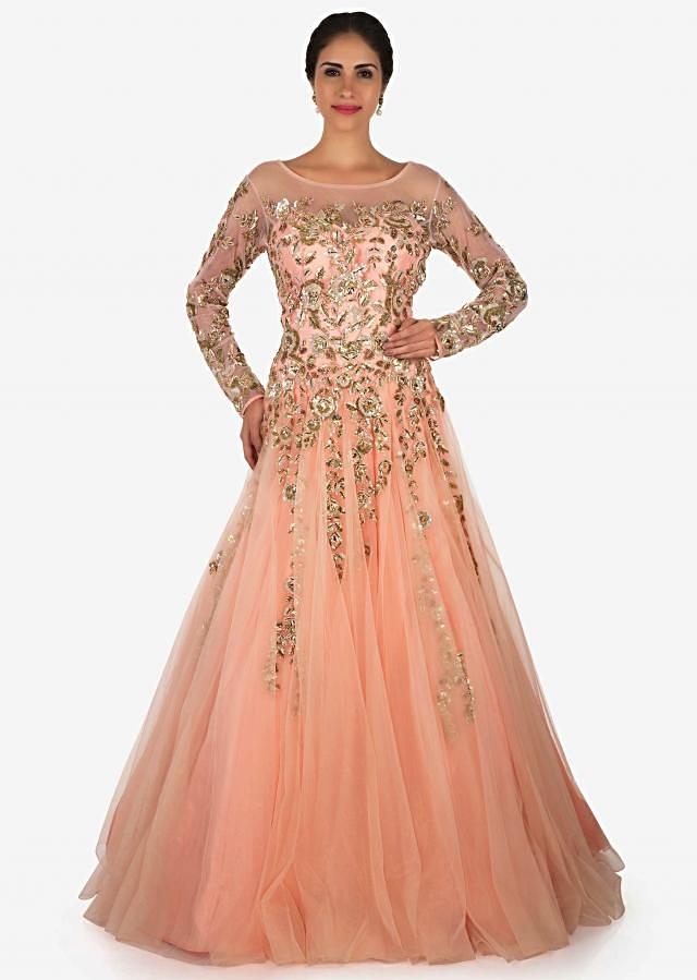 Peach gown in net adorn in moti and zardosi embroidery work only on Kalki