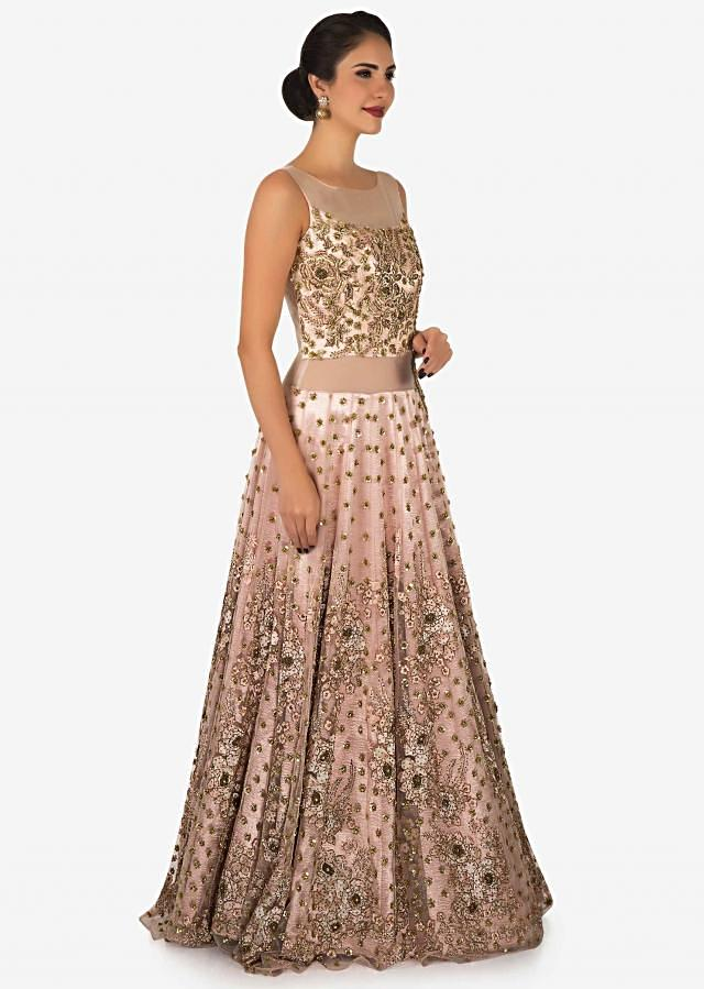 Peach gown in net adorn in zardosi and resham embroidered work only on Kalki