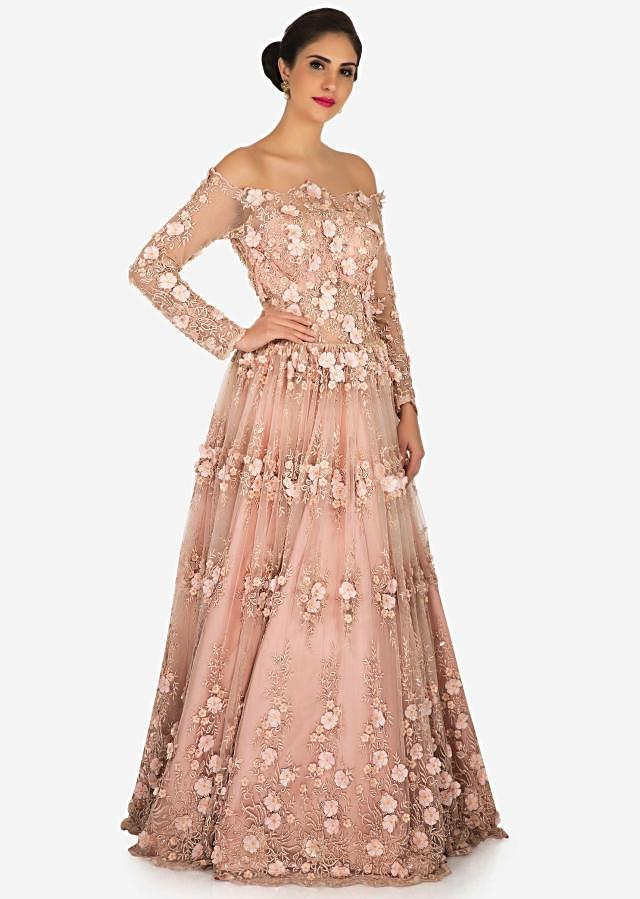 Peach gown in net beautified in resham and 3D flowers embroidery work only on Kalki
