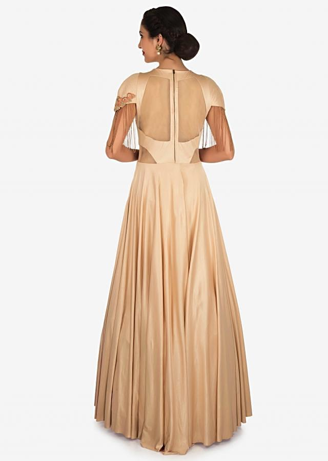 Peach gown in shimmer lycra carved in tassels and resham patchwork only on Kalki