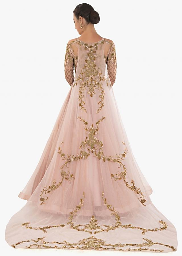 Peach gown with long trail in  embroidery bodice and fancy cut outs only on Kalki